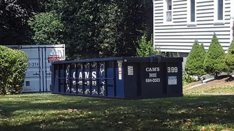 Cam's 15 Cubic Yard Dumpster Rental B99 on the job Notre Dame Road, Bedford, MA.