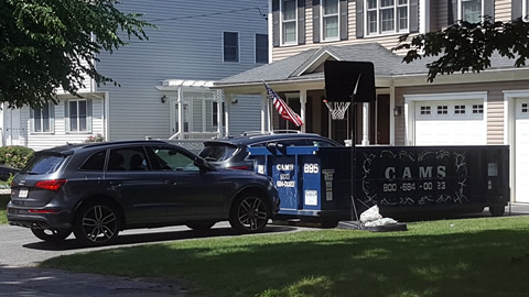 Cam's 15 Cubic Yard dumpster Rental On The job in Lexington, MA
