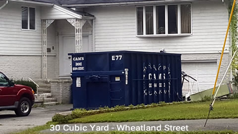 Cam's 30 cubic yard dumpster rental on the job in Peabody, MA